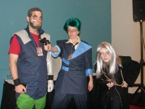 My family and I cosplaying Jet, Spike, and Vicious from Cowboy Bebop (left to right). Just try to ignore the super-boring convention center background!