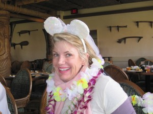 Lisa wearing three leis
