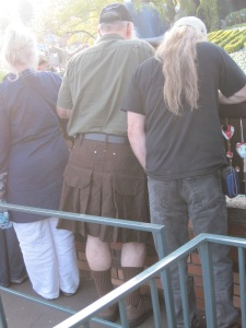 Man in a kilt waiting for Storyland boat ride