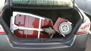 An ECV in the trunk of a full size rental car